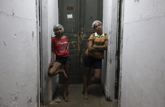 Members of Brazil's Movimento dos Sem-Teto (Roofless Movement) stand in the hallway of one of the 11 empty buildings that the movement took over recently, in the centre of Sao Paulo, November 6, 2012. According to City Hall, there are some 400,000 people in need of stable housing, including the 4,000 families of the Roofless Movement who are squatting in abandoned or vacant buildings that range from apartment blocks to hotels, in Sao Paulo, the largest city in South America. Picture taken November 6, 2012