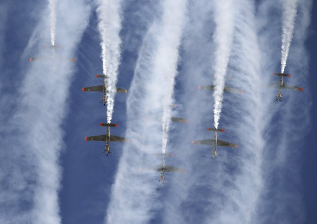 The Polish Air Force Orlik Aerobatic Team, flying PZL-130 Orlik aircraft, take part in a display during the Malta International Airshow at Malta International Airport, outside Valletta, Malta, September 27, 2015. (Photo by Darrin Zammit Lupi/Reuters)