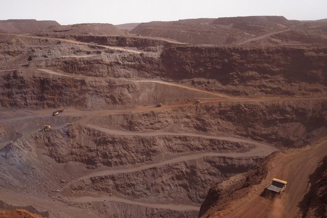 A truck drives along a road at the TO-14 iron ore mine in Zouerate June 23, 2014. Mauritania's SNIM iron ore mining company aims to produce 13 million tonnes in 2014, around the same level as last year, the majority state-owned firm said. (Photo by Joe Penney/Reuters)