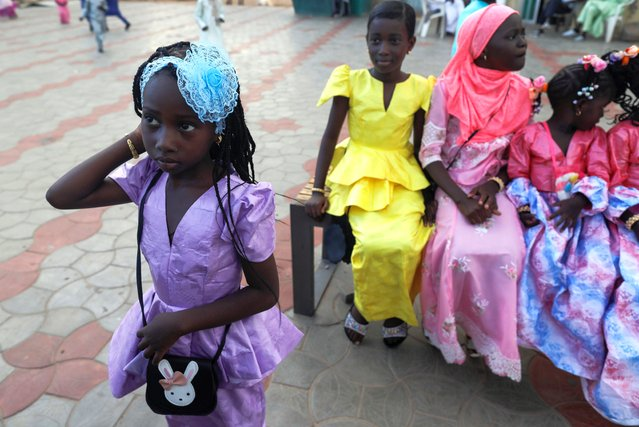 Girls wearing new clothes are pictured during the celebration of the first day of Eid al-Adha in Dakar, Senegal on July 31, 2020. (Photo by Zohra Bensemra/Reuters)