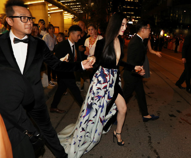 Actor Fan Bingbing is led across the street to fans by actors Dong Chenpeng and Tao Guo at the premiere of the film I Am Not Madame Bovary at TIFF the Toronto International Film Festival in Toronto, September 8, 2016. (Photo by Fred Thornhill/Reuters)