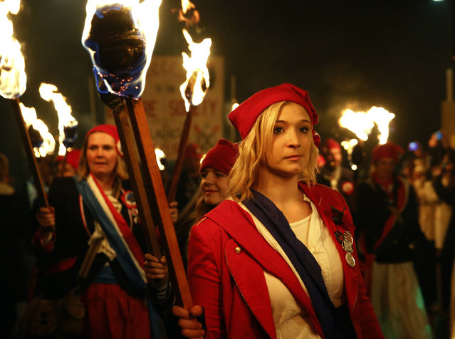 "Participants in costumes hold burning torches as they take part in one of a series of processions during Bonfire night celebrations in Lewes, southern England November 5, 2014. The processions and bonfire mark the uncovering of Guy Fawkes' ""Gunpowder Plot"" to blow up the Houses of Parliament in 1605, and commemorate the memory of Lewes' seventeen Protestant martyrs. (Photo by Luke MacGregor/Reuters)"