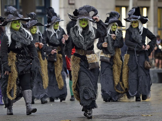 Revellers dressed as witches walk to the traditional start of the carnival season in Cologne, Germany, Tuesday, November 11, 2014. (Photo by Martin Meissner/AP Photo)