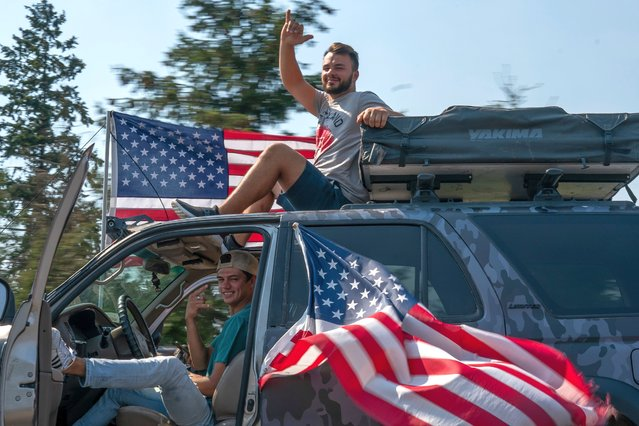 Supporters of President Trump drive south during a rally on September 7, 2020 in Clackamas, Oregon. A Pro-Trump caravan drove into the Oregon state capitol Monday afternoon where far-right protesters clashed with counter protesters. (Photo by Nathan Howard/Getty Images)