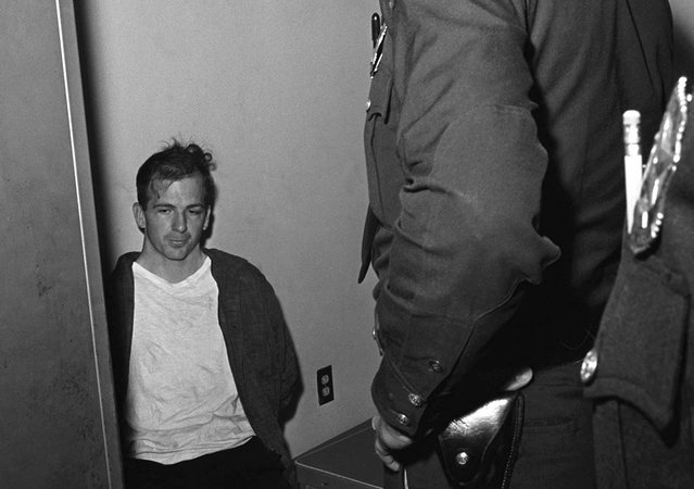 Lee Harvey Oswald sits in police custody shortly after being arrested for the assassination President John F. Kennedy, and the murder of Dallas police officer J. D. Tippit, in Dallas, Texas, on November 22, 1963. (Photo by AP Photo)