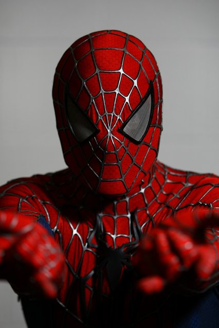 An actor dressed as Spiderman poses for a photo at the London Super Comic Convention at the ExCeL Centre on February 23, 2013 in London, England. Enthusiasts at the Comic Convention are encouraged to wear a costume of their favourite comic character and flock to the ExCeL to gather all the latest news in the world of comics, manga, anime, film, cosplay, games and cult fiction. (Photo by Jordan Mansfield)