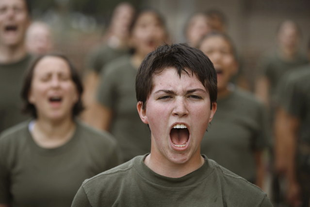 Female Marine recruits respond to their drill instructor as they are disciplined with some unscheduled physical training in the sand pit outside their barracks during boot camp February 27, 2013 at MCRD Parris Island, South Carolina. Female enlisted Marines have gone through recruit training at the base since 1949. About 11 percent of female recruits who arrive at the boot camp fail to complete the training, which can be physically and mentally demanding. On January 24, 2013 Secretary of Defense Leon Panetta rescinded an order, which had been in place since 1994, that restricted women from being attached to ground combat units. About six percent of enlisted Marines are female. (Photo by Scott Olson/AFP Photo)