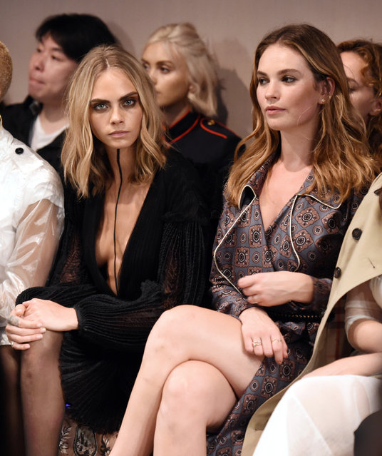 Cara Delevigne and Lily James in the front row Burberry show, London Fashion Week, UK on September 19, 2016. (Photo by Photo by David Fisher/Rex Features/Shutterstock)