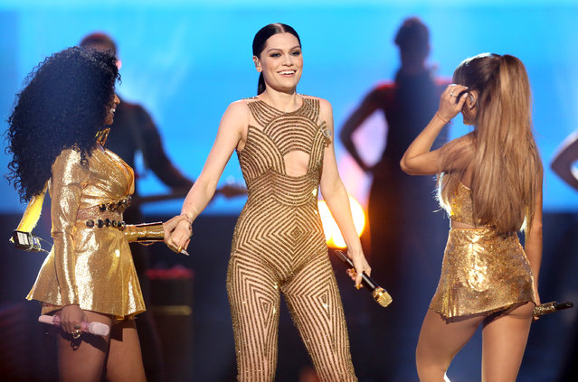Nicki Minaj, from left, Jessie J and Ariana Grande perform at the 42nd annual American Music Awards at Nokia Theatre L.A. Live on Sunday, November 23, 2014, in Los Angeles. (Photo by Matt Sayles/Invision/AP Photo)