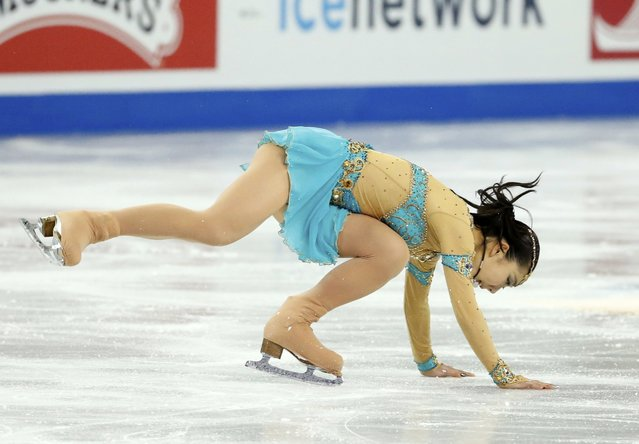 Miyu Nakashio of Japan falls as she performs during the ladies' free skating program at the Skate America figure skating competition in Milwaukee, Wisconsin October 24, 2015. (Photo by Lucy Nicholson/Reuters)