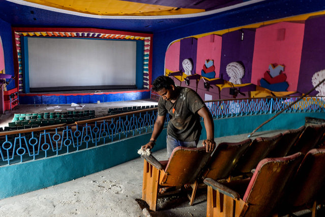 A worker cleans a cinema hall as part of preparations for a possible reopening after the government eased lockdown restrictions previously imposed due to the Covid-19 coronavirus, in Chennai on October 3, 2020. Deaths from the novel coronavirus in India passed 100,000 on October 3, official data showed as the pandemic continued to rage across the world's second most populous country. (Photo by Arun Sankar/AFP Photo)