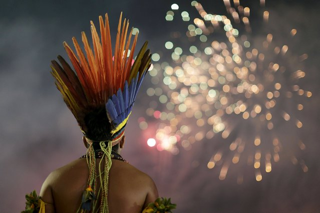 An indigenous man watches fireworks during the first World Games for Indigenous Peoples in Palmas, Brazil, October 24, 2015. (Photo by Ueslei Marcelino/Reuters)