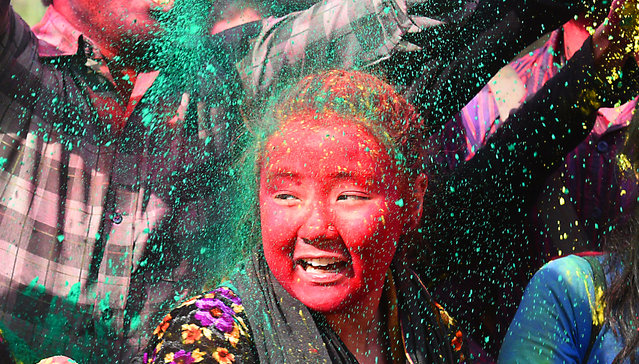 Students celebrate the Holi festival  on March 1, 2018 in New Delhi, India. (Photo by Raj K. Raj/Hindustan Times via Getty Images)