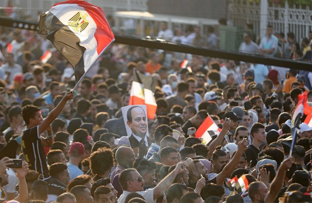 Supporters of Egyptian President Abdel Fattah Al-Sisi holding banners and Egyptian flags, gather to celebrate the 47rd anniversary of the 1973 Arab-Israeli war, in Cairo, Egypt on October 2, 2020. (Photo by Mohamed Abd El Ghany/Reuters)