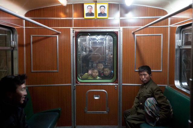 Children look through a subway car window in Pyongyang, North Korea, on March 10, 2011. (Photo by David Guttenfelder/AP Photo)