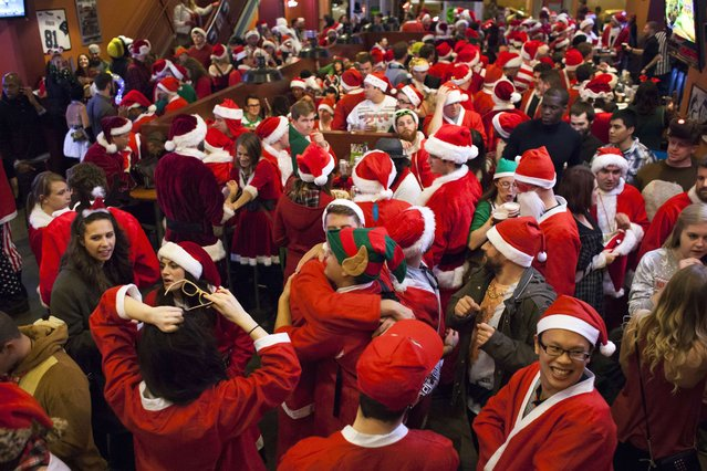 Santarchy participants fill Gameworks in Seattle, Washington December 13, 2014. (Photo by David Ryder/Reuters)