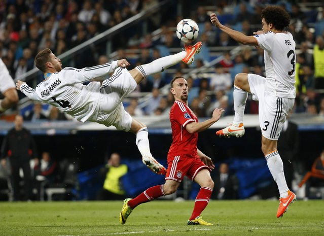 Real Madrid's Sergio Ramos jumps to block a pass from Bayern Munich's Frank Ribery as Pepe watches during their Champions League semi-final first leg soccer match at Santiago Bernabeu stadium in Madrid in this April 23, 2014 file photo. (Photo by Paul Hanna/Reuters)