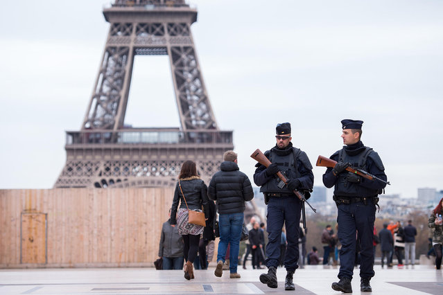 Police officers patrol at Place du Trocadero near the Eifel tower in Paris, France, 14 November 2015. At least 120 people were killed in a series of terrorist attacks in Paris. (Photo by Marius Becker/DPACorbis)