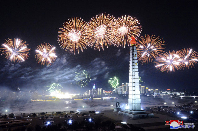 In this photo provided by the North Korean government, fireworks explode over Pyongyang, in the celebration of the ruling party congress, at Kim Il Sung Square in Pyongyang, North Korea Thursday, January 14, 2021. (Photo by Korean Central News Agency/Korea News Service via AP Photo)