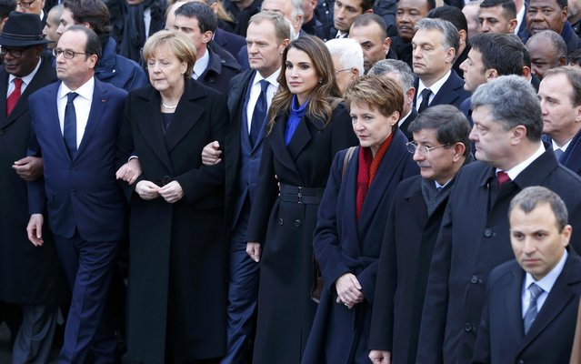 French President Francois Hollande is surrounded by Heads of state including (LtoR) Germany's Chancellor Angela Merkel, European Council President Donald Tusk, Jordan Queen Rania Al Abdullah and Switzerland's President Simonetta Sommaruga as they attend the solidarity march (Marche Republicaine) in the streets of Paris January 11, 2015. (Photo by Yves Herman/Reuters)