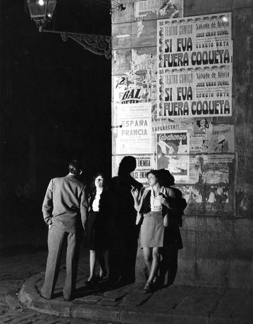 Two prostitutes talking to a client on a Barcelona street corner.  Original Publication: Picture Post - 5243 - Barcelona a City in Ferment - pub. 1951   (Photo by Bert Hardy/Getty Images)
