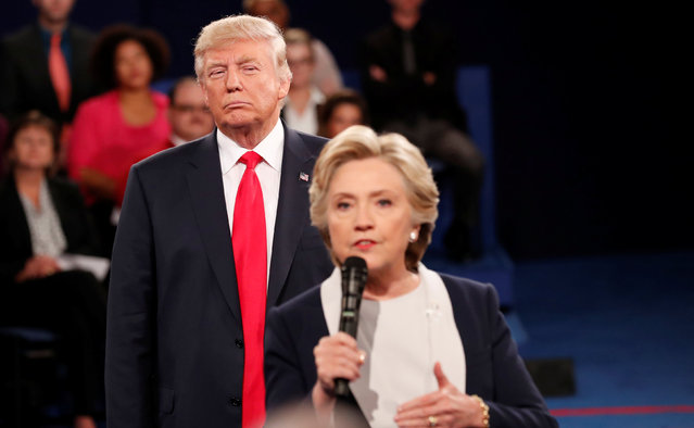 Republican U.S. presidential nominee Donald Trump listens as Democratic nominee Hillary Clinton answers a question from the audience during their presidential town hall debate at Washington University in St. Louis, Missouri, U.S., October 9, 2016. (Photo by Rick Wilking/Reuters)