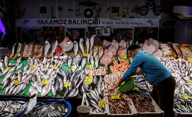 People shop at a fish market at Karakoy district in Istanbul, Turkey, January 8, 2021. (Photo by Umit Bektas/Reuters)