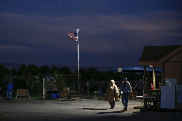 Residents walk at night at Camp Hope in Las Cruces, New Mexico October 5, 2015. (Photo by Shannon Stapleton/Reuters)