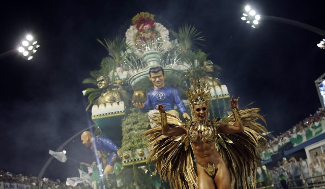 A reveller from Mancha Verde Samba School takes part in a carnival at Anhembi Sambadrome in Sao Paulo February 14, 2015. (Photo by Nacho Doce/Reuters)
