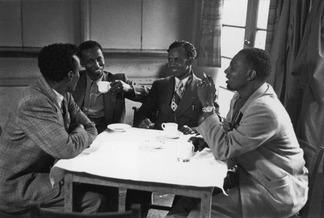 """A group of Somalians meet for a drink and a smoke at a cafe in Bute Town or """"Tiger Bay"""", Cardiff, 22nd April 1950. (Photo by Bert Hardy/Picture Post/Hulton Archive/Getty Images)"""