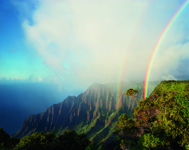 "A double rainbow arcs above the jagged cliffs and dense vegetation of Kalalau, the largest valley on Na Pali, Hawaii, 2011. This image is featured in National Geographic's exhibition ""Women of Vision: National Geographic Photographers on Assignment"". (Photo by Diane Cook & Len Jenshel/National Geographic)"