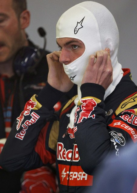 Toro Rosso Formula One driver Max Verstappen of the Netherlands puts on his balaclava during the second practice session of the Australian F1 Grand Prix at the Albert Park circuit in Melbourne March 13, 2015.    REUTERS/Brandon Malone
