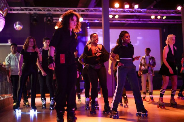 People attend a roller skating disco at Roller Nation, as the coronavirus disease (COVID-19) restrictions continue to ease, in London, Britain, May 17, 2021. (Photo by Henry Nicholls/Reuters)