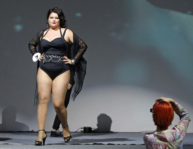 """A contestant seen on stage during the """"Miss Ukraine Plus Size"""" beauty pageant in Kiev, Ukraine on October 29, 2018. 22 female contestants competed in the contest, the first held in Ukraine, which aims to challenge modern inclusive standards of beauty. The winner of  the contest will represent Ukraine to the """"Miss World Plus Size 2018"""" beauty pageant, wich will take place in the Philippines on November 07-11. (Photo by Pavlo Gonchar/SOPA Images via ZUMA Wire)"""