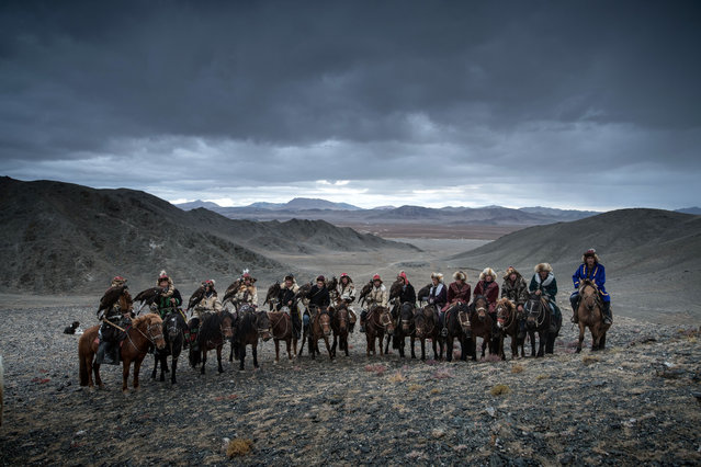 The photos show a group of 10 eagle hunters travelling between West and South Mongolia and across the Gobi Desert. (Photo by Daniel Kordan/Caters News Agency)