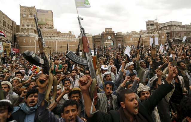 Shi'ite Muslim rebels hold up their weapons during a rally against air strikes in Sanaa March 26, 2015. Warplanes from Saudi Arabia and Arab allies struck Shi'ite Muslim rebels fighting to oust Yemen's president on Thursday, in a major gamble by the world's top oil exporter to check Iranian influence in its backyard without direct military backing from Washington. (Photo by Khaled Abdullah/Reuters)