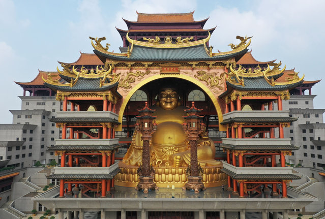 """The world's largest indoor Buddha statue, which is 300 metres high and weighs 600 tonnes, in the Yun Tian Gong complex, Guangxi Zhuang, China on November 26, 2018. A grand architecture """"Yun Tian Gong"""" in Yulin city, south China's Guangxi, has become a pilgrimage site for Buddhism believers. Located upon the Nanliu River, the 21-storey palace covers an area of 140,000 square meters, with a height of 108 meters. The world's largest indoor Buddha statue with a height of 30 meters and a weight of 600 tons is enshrined in it. Known as the Guangxi's """"Potala Palace"""", the building was built by a Taiwanese businessman with 2 billion yuan (USD$300 million). (Photo by Imaginechina/Rex Features/Shutterstock)"""