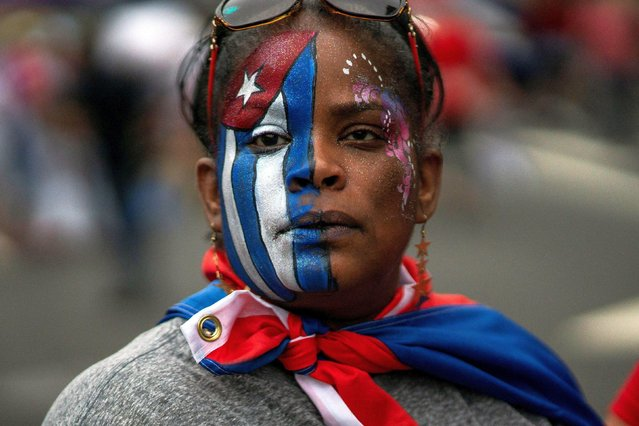 A member of an exiled Cuban community attends a march as the community reacts to reports of protests in Cuba against the deteriorating economy, in North Bergen, New Jersey, U.S., July 13, 2021. (Photo by Eduardo Munoz/Reuters)