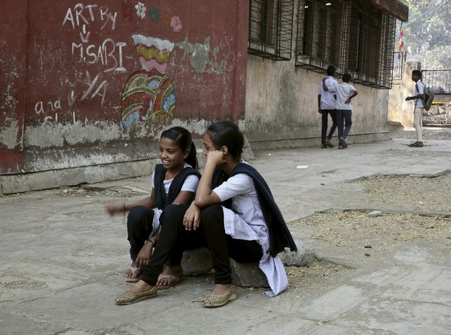 Female students sit in the playground of Shahaji Nagar Municipal Hindi School at Cheeta Camp area in Mumbai, February 24, 2015. As India grapples to stem rising violence against women, activists say classes like these – which confront traditional gender roles and challenge sexism amongst the youth – are key to changing attitudes and curbing widespread gender abuse. (Photo by Nita Bhalla/Reuters)