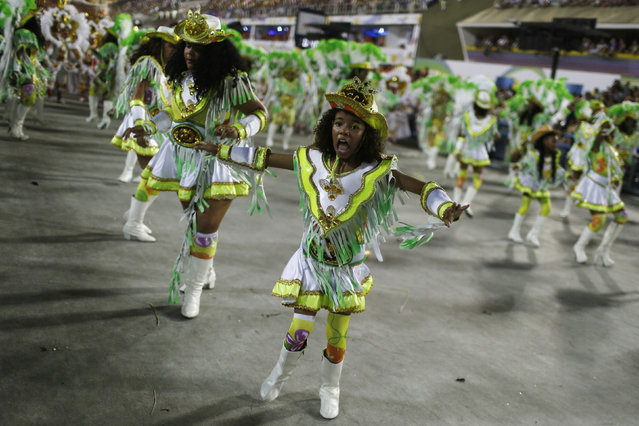 Revellers of the Imperatriz samba school perform during the carnival parade at the Sambadrome in Rio de Janeiro, February 9, 2016. (Photo by Pilar Olivares/Reuters)