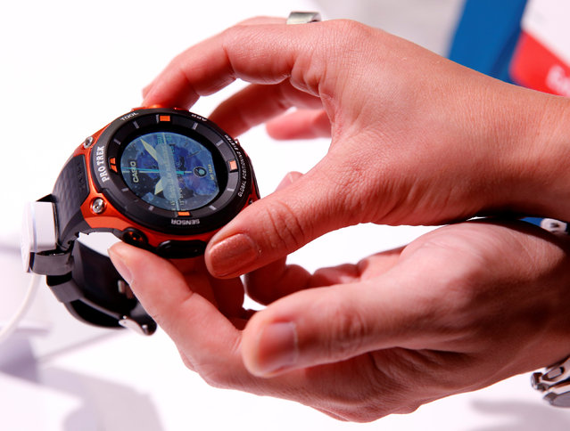 Attendees look over a Casio WSD-F20 Pro Trek Smart watch with built-in GPS, expected to be available in April according to a representative, during the 2017 CES in Las Vegas, Nevada January 5, 2017. (Photo by Steve Marcus/Reuters)