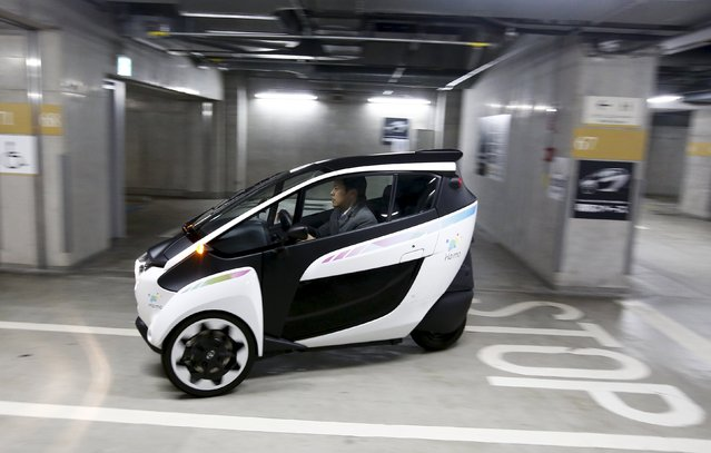 A Toyota i-Road electric vehicle drives in a underground parking lot in Tokyo April 9, 2015. Tokyoites will get a chance to zip around town on Toyota Motor Corp's three-wheeled electric car-cum-motorbike from Friday, in a trial aimed at crafting a global business model to reduce gridlock and pollution. (Photo by Thomas Peter/Reuters)