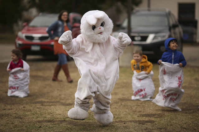 Caleb Smith, in the bunny suit, jumps in a bunny hop race Sunday, April 5, 2015, at the event for Easter in Bloomington, Minn. (Photo by Jeff Wheeler/AP Photo/Star Tribune)