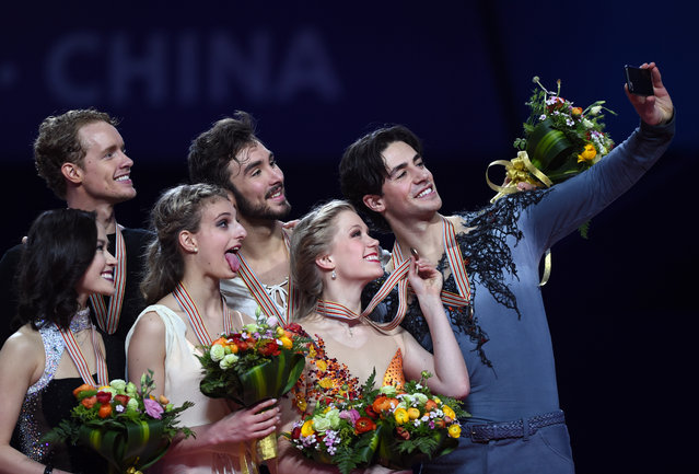 (L-R) Silver medalists Madison Chock and Evan Bates of the US, gold medalists Gabriella Papadakis and Guillaume Cizeron of France and bronze medalists Kaitlyn Weaver and Andrew Poje of Canada pose during the awards ceremony of the ice dance of the 2015 ISU World Figure Skating Championships at Shanghai Oriental Sports Center in Shanghai, on March 27, 2015. (Photo by Johannes Eisele/AFP Photo)