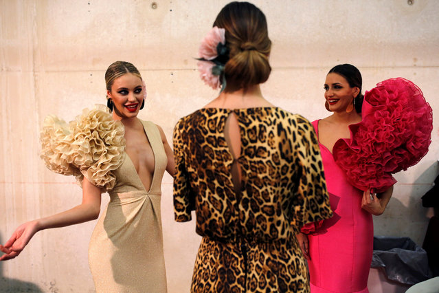 Models are seen backsstage as they wear creations by Ana Moron during the International Flamenco Fashion Show SIMOF in the Andalusian capital of Seville, Spain February 8, 2019. (Photo by Marcelo del Pozo/Reuters)