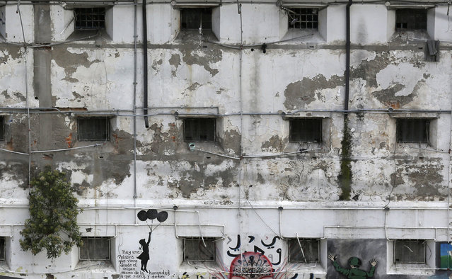 This April 9, 2015 photo shows prison cell windows facing an interior courtyard at the now empty Garcia Moreno Prison, during a guided tour for the public in Quito, Ecuador. The building's fate remains undecided, but authorities say one project being looked at would convert the old prison in the heart of the city into a luxury hotel. Another proposal would convert it into a city museum. (Photo by Dolores Ochoa/AP Photo)