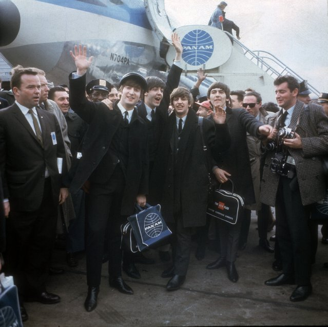 In this February 7, 1964 file photo, the Beatles arrive in New York for their first U.S. appearances. From left are: John Lennon, Paul McCartney, Ringo Starr and George Harrison. McCartney turned 70 Monday June 18, 2012. (Photo by AP Photo)