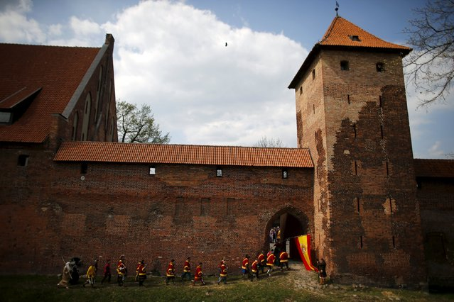 The Spanish team walks before taking part in the opening ceremony parade of the Medieval Combat World Championship at Malbork Castle, northern Poland, April 30, 2015. Medieval combat is a full contact sport that revives the foot based tournament fighting of medieval Europe. Countries fight in refereed matches where the objective is to get the opposing team to the floor. (Photo by Kacper Pempel/Reuters)