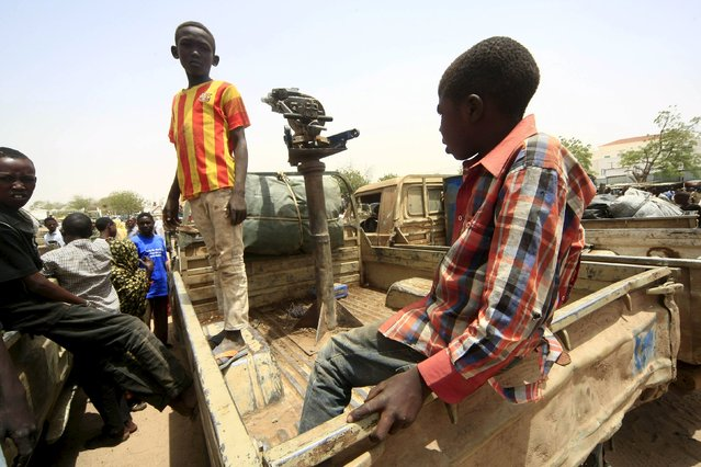 Children sit inside a vehicle of the Justice and Equality Movement (JEM) rebels during a display after victory celebrations by Sudanese Armed Forces (SAF) and the Rapid Support Forces (RSF) in Niyla Capital of South Darfur, May 4, 2015. (Photo by Reuters/Stringer)