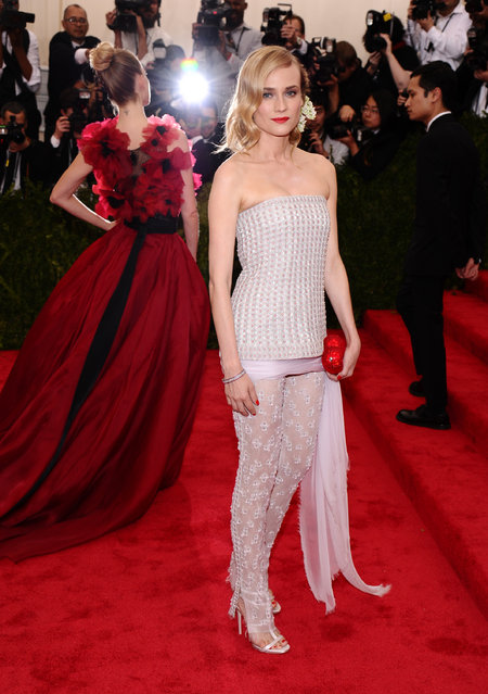 """Diane Kruger arrives at The Metropolitan Museum of Art's Costume Institute benefit gala celebrating """"China: Through the Looking Glass"""" on Monday, May 4, 2015, in New York. (Photo by Charles Sykes/Invision/AP Photo)"""